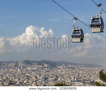 Barcelona,spain-october 9,2014: Two Cabins Of Cableway Park Montjuic, City At Background,barcelona.