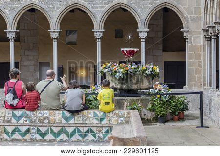 Barcelona,spain- June 22,2014: Colister Of Monastery Santa Maria De Pedralbes. Family Watching Tradi