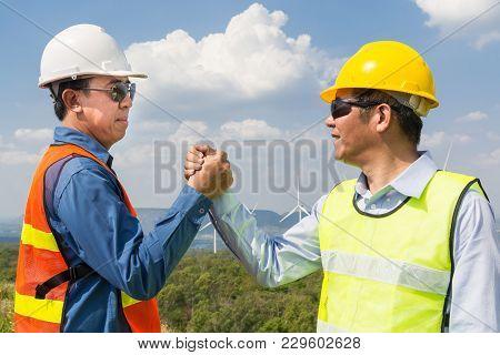 Architect And Engineer Shake Hand