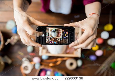 Top View Close Up Of Unrecognizable Woman Taking Picture Of Easter Set Up Via Mobile Phone, Copy Spa