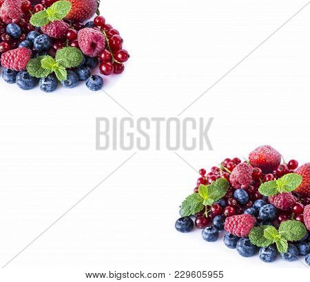 Mix Berries And On A White Background. Ripe Blueberries, Raspberries, Red Currants And Strawberries