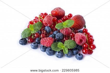 Mix Berries And Isolated On A White. Ripe Blueberries, Raspberries, Red Currants And Strawberries Wi