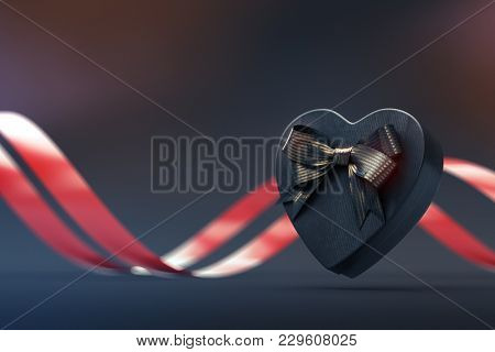 Black heart shaped gift box with golden bow and red curved ribbon on black. 3D render