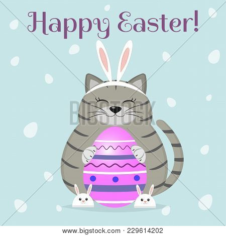 A Cute And Fat Gray Cat, In The Ears And Slippers Of A Rabbit, Sits And Holds A Purple Easter Egg. C
