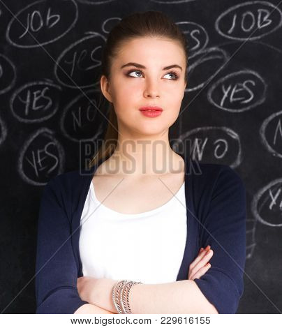 Thinking young woman with yes or no choice on gray background