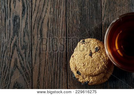Glass Cup Of Earl Grey Or Black Tea With Chocolate Chips Cookies Decorated With Light Cotton Napkin