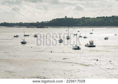 View Of Boats And Yachts Lying On Sea Floor During Low Tide In Cancale, Brittany, France