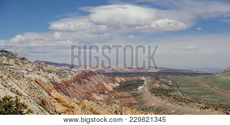 Capitol Reef, Central Utah, Usa. Panoramic Overview To Valley And Mountains With Beautiful Lens Clou