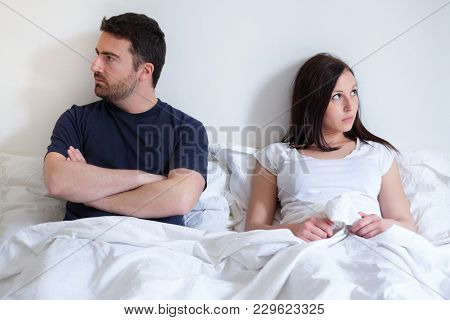Worried And Bored Lovers Couple After Arguing And Lying In The Bed