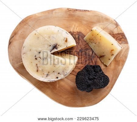Hard Truffle Cheese And Black Truffles On A Cutting Board Isolated On White. Top View.