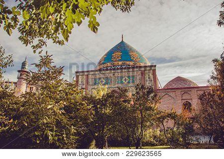 Blue Mosque Behind Yard Garden. Elegant Islamic Masjid Building. Travel To Armenia, Caucasus. Touris