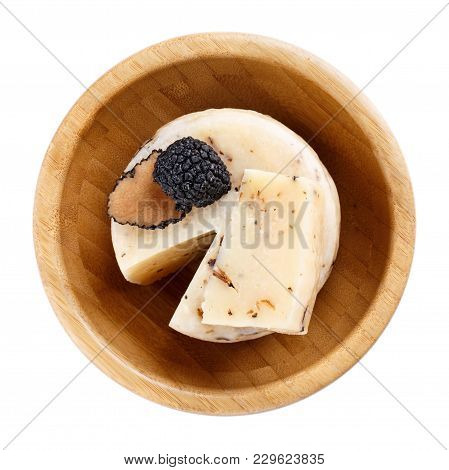 Hard Truffle Cheese And Black Truffles In Wooden Bowl Isolated On White. Top View.