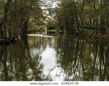 Reflections On The River Arnoia In The Village Of Allariz, Galicia, Spain.