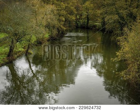 Reflections Of Trees In Autumn On The Arnoia River, Allariz, Galicia. Spain