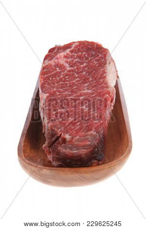 three fresh raw marble beef meat sirloin porterhouse steak on long wooden tray isolated on white background