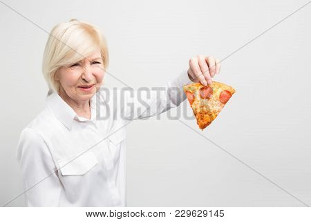 Grandma Doesn't Like The Idea Of Eating This Piece Of Pizza Because It Is Not Good And Helthy For Hu
