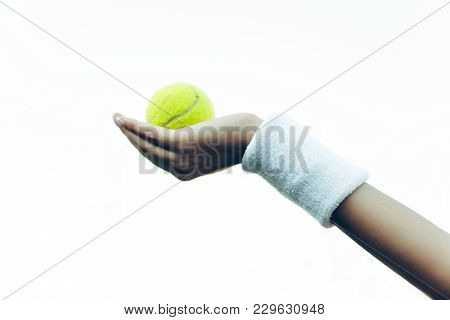 Play With It! Close-up Part Of Woman Hand Holding Tennis Ball On The Tennis Court.