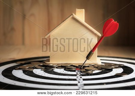 Red Dart Arrow Hit The Center Target Of Dartboard With House And Money Coin Metaphor Marketing Or Sa