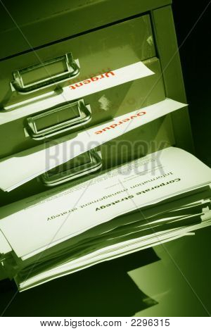 Documents And Files Bulging Out Of A Filling Cabinet