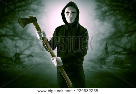 Armed aggressive hunter in abandoned thick forest graveyard concept