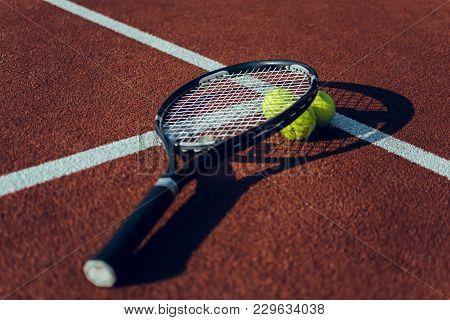 Tennis Racket And Balls. Tennis Rackets And Tennis Balls Lying Down On Tennis Court.