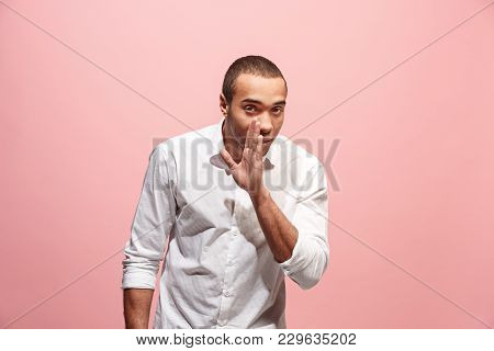 Secret, Gossip Concept. Young Man Whispering A Secret Behind His Hand. Afro Businessman Isolated On