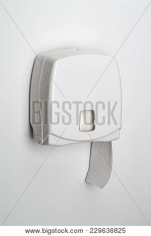 Dispenser For Toilet Paper Isolated On White Background
