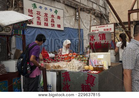 Xian, China - August 5, 2012: A Food Stall In A Street Of The Muslim Quarter In The City Of Xian In