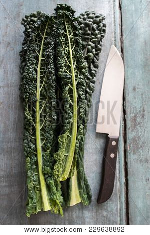 Overhead View Of Cavolo Nero Leaves With Knife