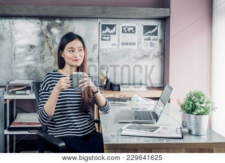Asian Businesswoman Take A Coffee Break After Working With Smiling Face,happy Office Life Concept,wo