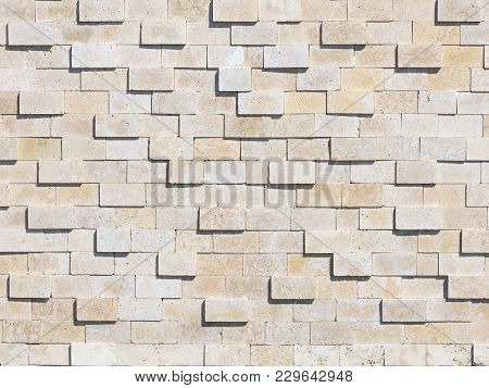 Wall Of Light Natural Stone Tufa, Laid Like Bricks And Some Stones Protrude Above The Surface