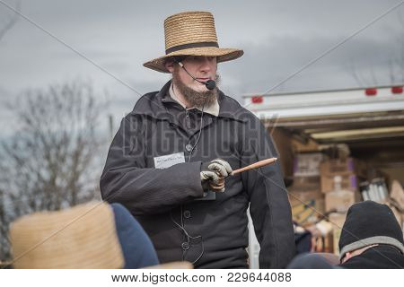 Amish Auctioneer At Mud Sale