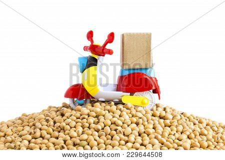 Express Delivery Service By Motorcycle.colorful Motorcycle With Delivery Boxes On Pile Soybeans On T