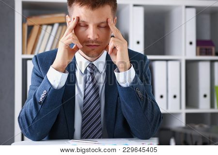 A Man Experiences Stress And A Headache In The Workplace Experiences Negative Emotions From Paper Re
