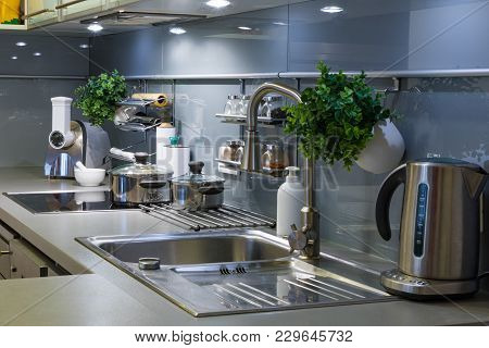 Modern Kitchen In Grey Colors At Home With Kitchenware