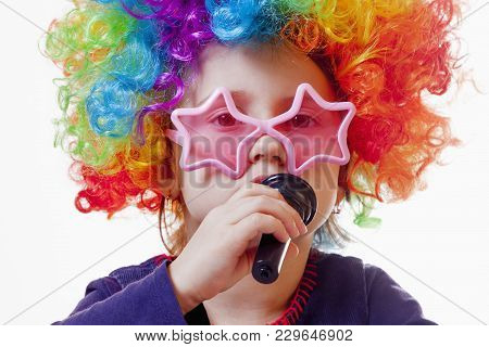 The Famous Actress. Humorous Photocute Child Girl Singing With A Microphone (happy Childhood, Teachi