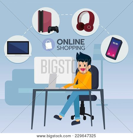 Happy Young Man Sit In Front Computer, Search And Buy Electronic Item, Game, Smartphone, Notebook Fr