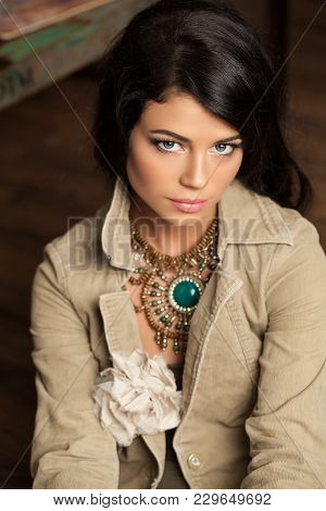 Beautiful Female Face. Perfect Lady With Elegant Hairstyle And Fashion Clothes