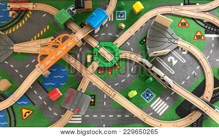 Top View Of Toy Wood Train And Rail Set, Education And Transportation Concept