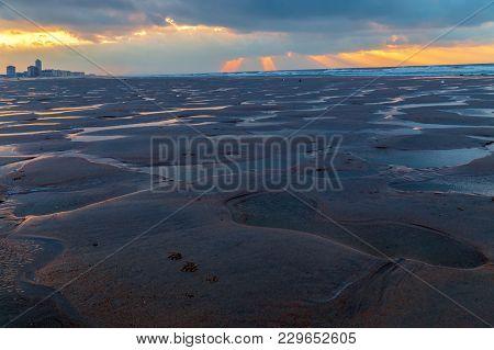 Lunar Landscape On The Beach In Ostende, Belgium, North Sea After Reflux.