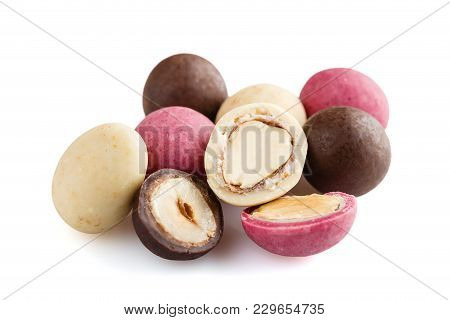 Heap Of Sugared Almonds And Hazelnuts Dragees In Chocolate Isolated On White Background