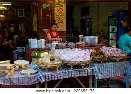 Chiang Khan, Thailand - Dec 31, 2014 : Seller Preparing Breakfast For Customers On Chiang Khan Walki