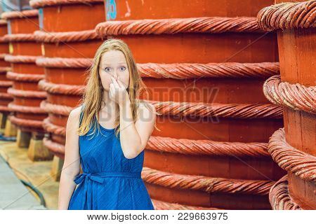 The Woman Shows How Stinks Fish Sauce On Phu Quoc, Vietnam.