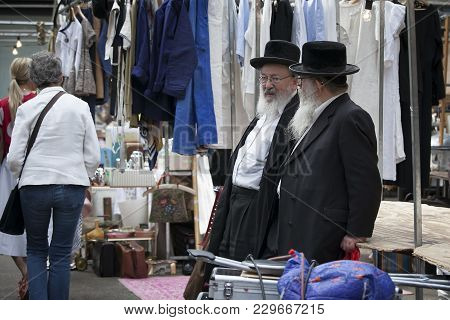 London, Uk - August 27, 2016: Two Elderly Orthodox Jewish Men With Beards Wearing Black Coats And Ha