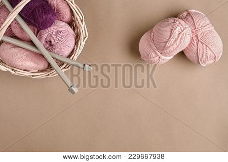 Yarn Balls. Balls Of Colored Yarn In A Wicker Dish. Yarn For Knitting On A Beige Background. Knittin