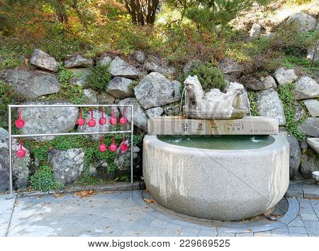 Holy Spring Water With Dipper For Drink At Seokguram Grotto Temple Gyeongju, South Korea.