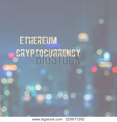 The words Ethereum Cryptocurrency in a modern sans-serif font with a background of a blurred business district.