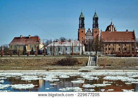 Urban Landscape With River Warta And The Cathedral Towers In Winter In Poznan