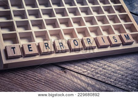 Macro Of The Word Terrorism Formed By Wooden Blocks In A Typecase