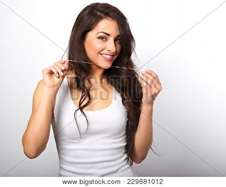 Happy Smiling Woman Cleaning The Teeth The Dental Floss On White Background With Empty Copy Space. D
